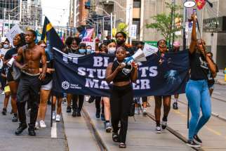 Marchers take to the streets of Toronto Aug. 3 demanding an end to systemic racism in schools.