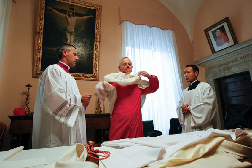 Washington Cardinal Donald W. Wuerl puts on his vestments as he prepares to take possession of Rome's Basilica of St. Peter in Chains in 2011. Pope Francis has accepted the resignation of Cardinal Wuerl as archbishop of Washington but did not name a successor.