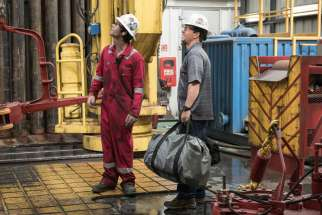 "Dylan O'Brien and Mark Wahlberg star in a scene from the movie ""Deepwater Horizon."""