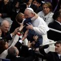 This photo by AP photographer Gregorio Borgia of Pope Francis embracing 8-year-old Dominic Gondreau, who has cerebral palsy, captured the attention of people around the world. The moment took place after the new pontiff celebrated his first Easter Mass i n St. Peter's Square at the Vatican March 31.