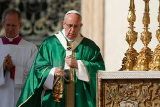 Pope Francis uses incense as he celebrates a jubilee Mass in honor of Mary in St. Peter's Square at the Vatican Oct. 9.