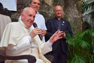 "Pope Francis speaks during a meeting with Jesuits and laypeople associated with Jesuit institutions in Cartagena, Colombia, Sept. 10. While replying to questions, the pope said that seeking to understand people's real lives does not ""bastardize"" theology. In the background is Jesuit Father Antonio Spadaro, editor of the Rome-based Jesuit journal, La Civilta Cattolica."