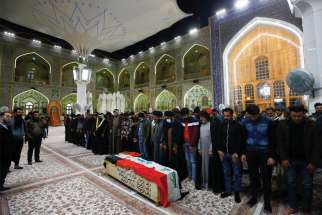 Mourners gather near the coffin of a man killed in a twin suicide bombing attack in a central Baghdad market during a funeral in Najaf, Iraq, Jan. 21. Cardinal Louis Sako, patriarch of the Chaldean Catholic Church, said Iraqis are still counting on Pope Francis to visit in March.