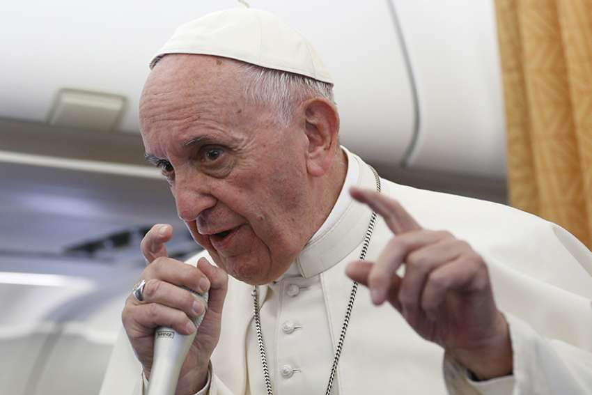 Pope Francis speaks to journalists aboard his flight from Cairo to Rome April 29.