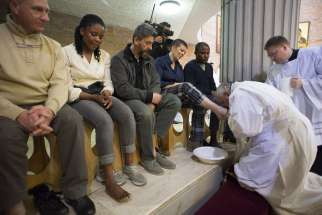 Pope Francis kisses the foot of a female inmate at Rome's Rebibbia prison April 2.