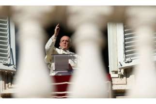 Pope Francis delivers his blessing as he leads the Angelus from his studio overlooking St. Peter's Square at the Vatican Dec. 8, the feast of the Immaculate Conception.