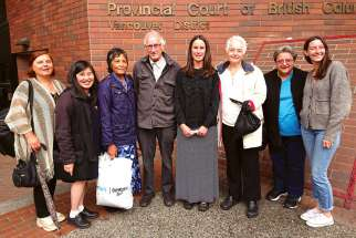 Mary Wagner, centre, was joined by her father Frank and other supporters after her sentencing hearing for being found guilty of mischief and trespassing at an abortion clinic in Vancouver.