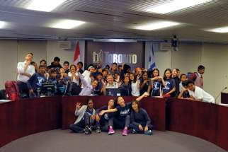 Roy Fernandes (wearing tie) joins St. Sylvester students having some fun with Toronto councillor Jim Karygiannis during a trip to City Hall.