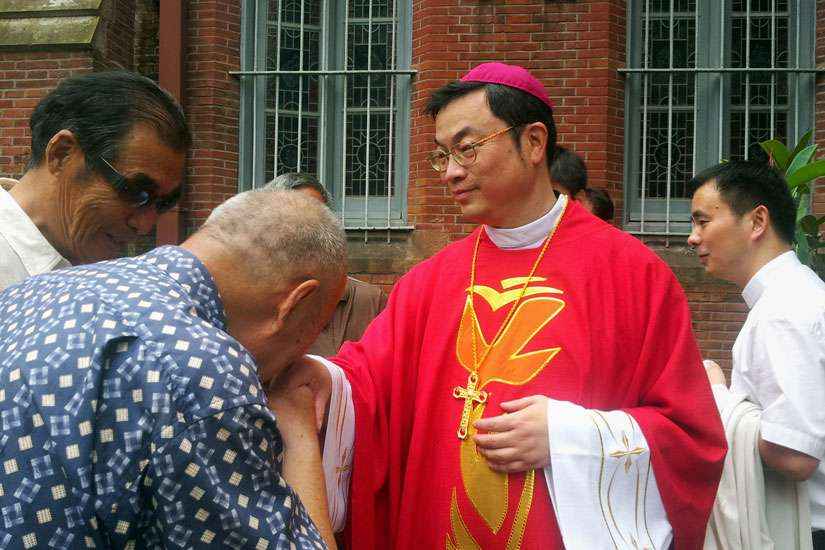 A well-wisher kisses the ring of Auxiliary Bishop Thaddeus Ma Daqin following his 2012 episcopal ordination at St. Ignatius Cathedral in Shanghai. The Vatican said it has had no direct contact with Bishop Ma, whose statement in a blog in June appeared to indicate that he had recanted an earlier decision to abandon the Chinese government's Catholic Patriotic Association.