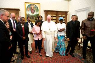 Pope Francis walks with family members of Asia Bibi, a Christian woman who will start a new life in Canada after being released from prison in Pakistan on blasphemy charges that carried a death sentence, during a private audience at the Vatican last February.