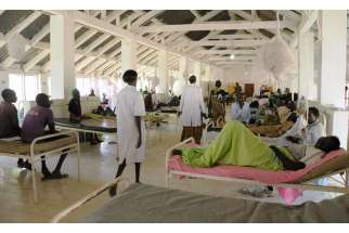 A general view shows South Sudanese patients Dec. 11 inside the surgery ward at the Bor teaching hospital after renewed conflict in Bor, South Sudan. Marking a year since South Sudan's latest war began, a Sudanese archbishop said the fighting has had a bitter impact on the nation, with communities sharply divided along ethnic lines.