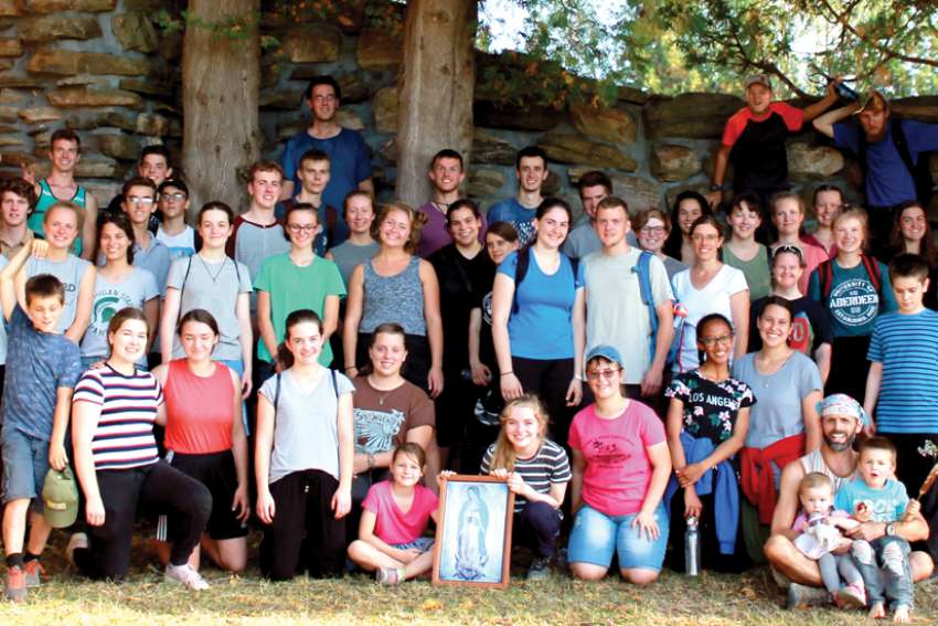 A group gathers after completing the annual Wilno Pilgrimage.