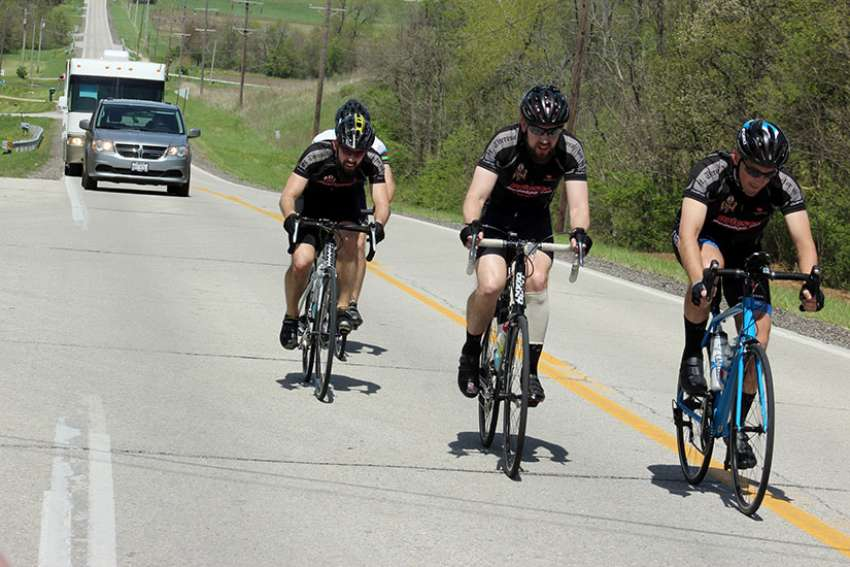The first leg of Priests Pedaling for Prayers took Father Michael Pica, Father Tom Otto and Father Adam Cesarek about 70 miles (113 km) over several major hills in central Illinois April 24. Support vehicles driven by parents Don Otto and Jim and Sandy Cesarek made certain the young priests and their friends were safe on the road during their five-day trek to promote religious vocations.