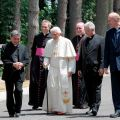 Pope Benedict XVI walks with Vatican officials and other clergy during a visit to the Society of the Divine Word's Ad Gentes center in the village of Nemi, Italy, July 9.
