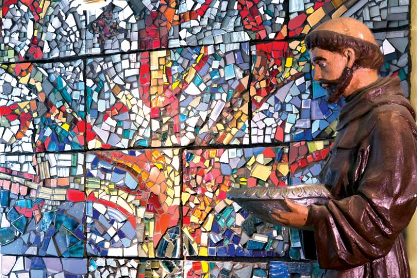 The Tree of Life mosaic created by students in the Student Alternative Learning program is on display at St. Francis Table, which serves meals to the needy in Toronto's Parkdale neighbourhood.