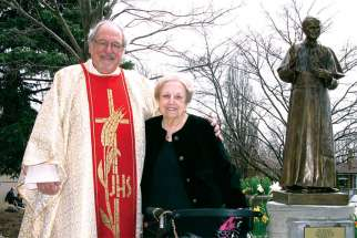 Fr. Massey Lombardi, pictured with his sister, is celebrating the 40th anniversary of his ordination to the priesthood.