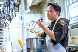 Capuchin Franciscan Br. Andrew Corriente prepares a buttercream icing in the kitchen at his friary in Washington. The 31-year-old third-year seminarian was the winner of the fifth season of ABC's The Great American Baking Show: Holiday Edition.