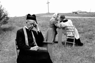 Jesuit priests hear confessions at the Martyr's Shrine, near Midland, Ontario, Canada, circa 1955.