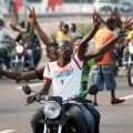 A crowd of supporters parades ahead of opposition leader Etienne Tshisekedi's convoy as he drives to a polling station in Kinshasa, Congo, Nov. 28. Catholic officials called for calm Nov. 29, a day after violent incidents were reported during Congo's presidential and legislative elections.
