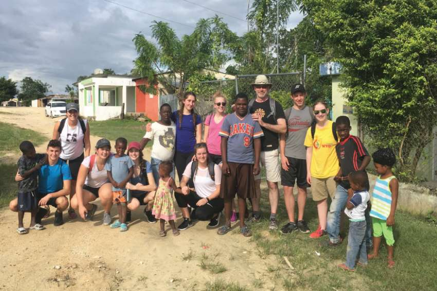 A group of students from the Waterloo Catholic board with local residents in the Dominican Republic.