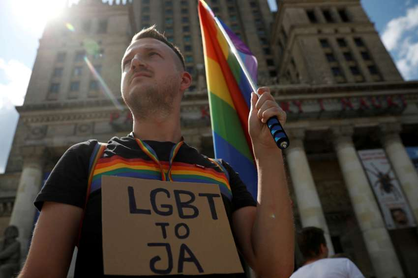 Pawel Szamburski, 29, participates in a July 27, 2019, protest in Warsaw, Poland, against violence that took place against the LGBTQ community during the first pride march in Bialystok in July.