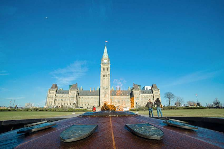 Ottawa's eternal flame is surrounded by the crests of every province and territory and in the shadow of the Peace Tower, burning on for the unity of a huge and diverse nation.