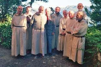 Trappist monks and a guest are pictured at the Monastery of Notre Dame de l'Atlas near Medea, Algeria, in this undated photo. Seven Trappist monks of the monastery were murdered in 1996 by the members of the Armed Islamic Group. They will be beatified Dec. 8 in Oran, Algeria.