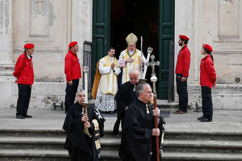 Members of the Knights of Malta and the prelate of the order, Bishop Jean Laffitte, walk in procession at the start of voting for a new leader in Rome May 2. The Knights elected Fra' Giacomo Dalla Torre as their new grand master from among 12 eligible knights to oversee the order for one year. The order's former grand master resigned amid a conflict with Pope Francis.
