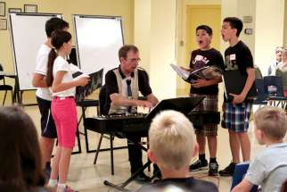 Uwe Lieflander shares his enthusiasm for sacred music with youngsters in the Sparrows program at Immaculate Conception parish in Port Perry, Ont.