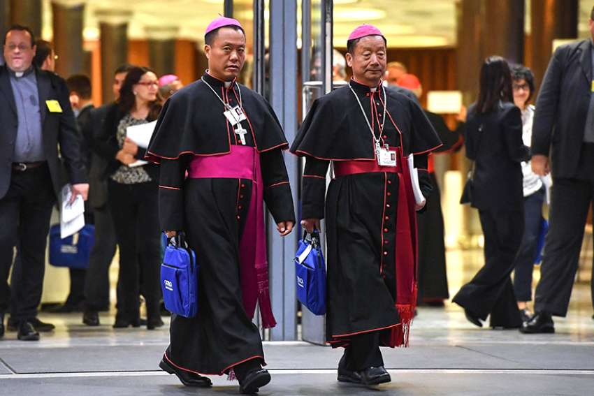 Chinese Bishops Joseph Guo Jincai of Chengde and Coadjutor Bishop John Baptist Yang Xiaoting of Yan'an depart the opening session of the Synod of Bishops on young people, the faith and vocational discernment at the Vatican Oct 3.