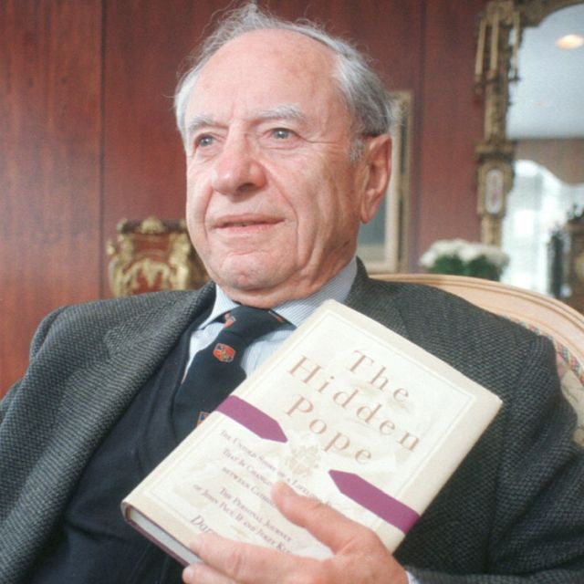 "Blessed John Paul II's lifelong friend Jerzy Kluger poses in 1998 with a copy of his book ""The Hidden Pope."""