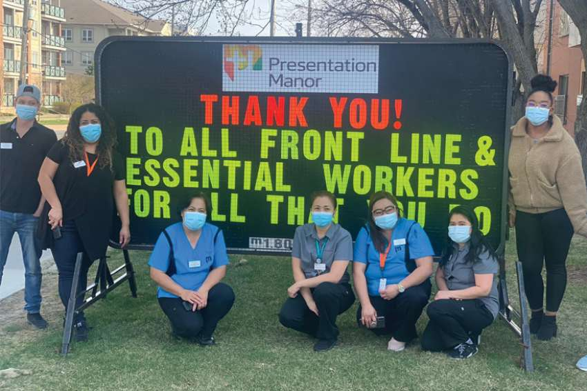 Some of the staff at Presentation Manor pose in front of a sign that says it all about the people that worked at keeping residents safe. About 100 people work at Presentation Manor.