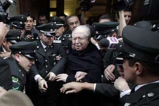 Chilean Father Fernando Karadima leaves after attending a 2015 hearing at the Supreme Court building in Santiago.
