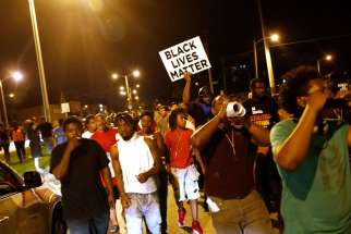 Protestors march Aug. 15 following the police shooting of a man in Milwaukee the previous day.