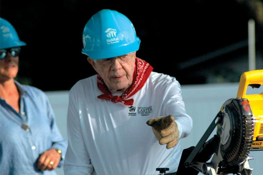 Former U.S. President Jimmy Carter helps build new homes for families through Habitat for Humanity.