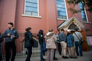 Voters wait outside a polling location for the presidential election Nov. 8 shortly after polls opened at Annunciation Church in Philadelphia.