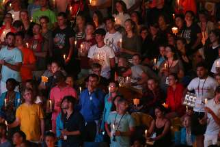 World Youth Day pilgrims hold candles during a prayer vigil in 2016 with Pope Francis at the Field of Mercy in Krakow, Poland.