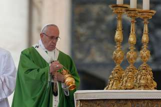 Pope Francis burns incense as he celebrates a Mass for the sick and disabled in St. Peter's Square at the Vatican June 12. The Mass was an event of the Jubilee of Mercy.
