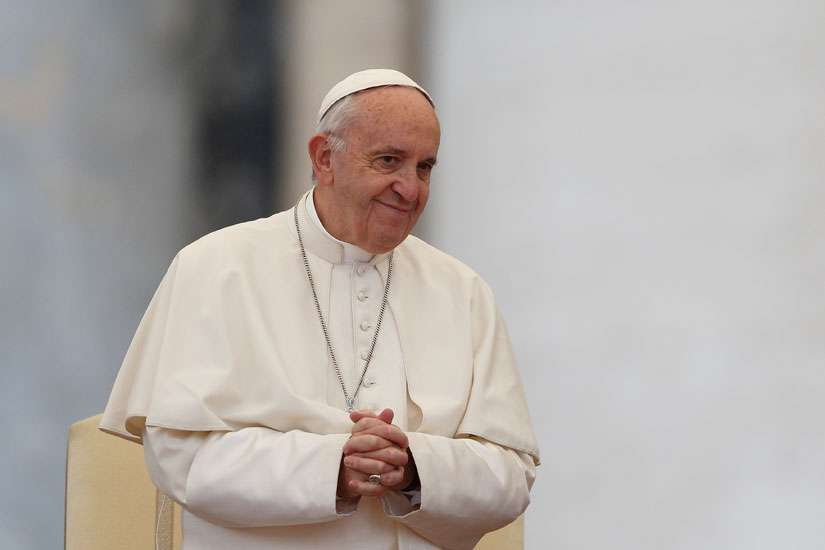 Pope Francis smiles as he leads his general audience in St. Peter's Square at the Vatican Oct. 26.