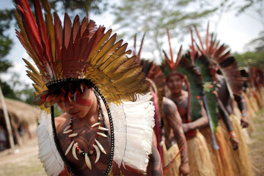 Shanenawa people dance during a festival to celebrate nature and ask for an end to the burning of the Amazon, in the indigenous village of Morada Nova near Feijo, Brazil.