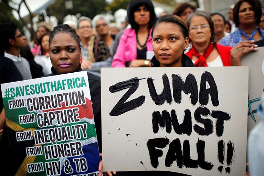 Demonstrators protest against South African President Jacob Zuma's firing of Finance Minister Pravin Gordhan outside Parliament March 31 in Cape Town.