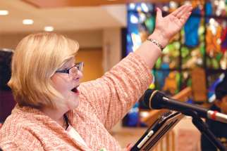 Kathy Irvin sees her role as cantor as inviting the assembly to be the singers of the Mass.