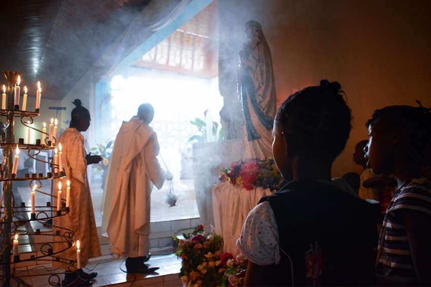 Faithful attend a Mass at St. Savior Catholic Church in Bangui, Central African Republic, in this 2015 file photo. The country's Christian and Muslim leaders designated May 10-12 as days of prayers for peace and reconciliation.