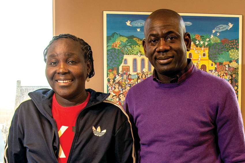 Victoria Filibus, left, has relied on support from Development and Peace to keep her nine children clothed, fed and in school while living in a displaced persons camp in Nigeria the last six years. She's pictured here with Isaac Asume Osuoka of D&P's Nigerian partner Social Action.