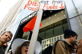 Protesters gather for a fossil fuel and climate change protest outside Trump Tower May 9 in New York City.