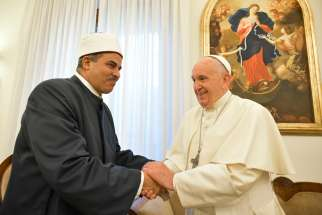 "Pope Francis shakes greets Mohamed Husin Abdelaziz Hassan, president of al-Azhar University, during a Sept. 11, 2019, meeting at the Vatican. The pope met with the committee working to fulfill the goals of the ""Document on Human Fraternity for World Peace and Living Together."""