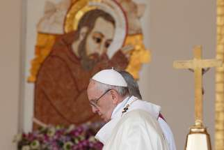 Pope Francis passes an image of St. Pio as he celebrates Mass at the Shrine of St. Pio of Pietrelcina in San Giovanni Rotondo, Italy, March 17.