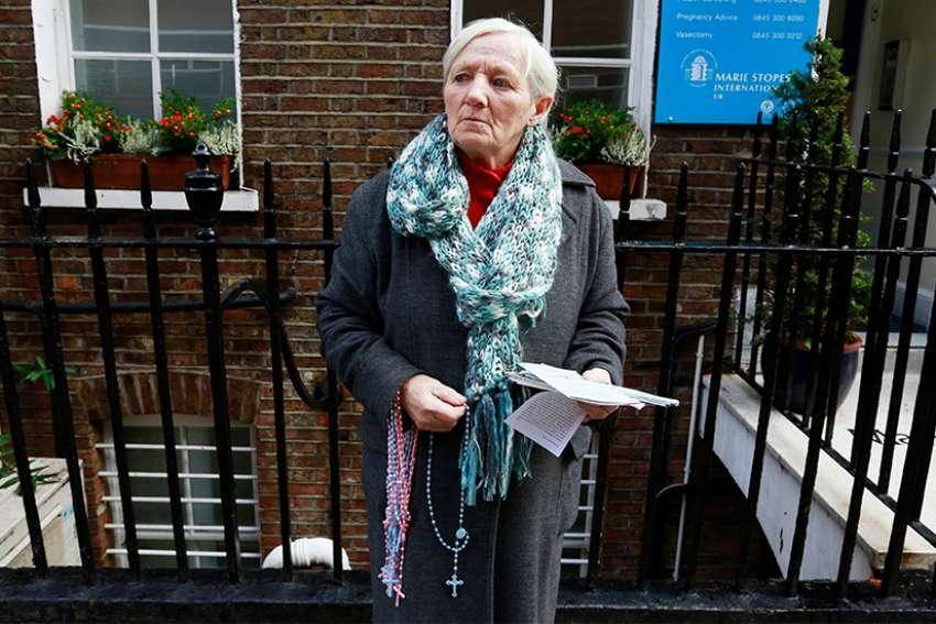 A woman prays the rosary in 2012 outside the Marie Stopes clinic in London. Members of Ealing Council, in the west of the capital, voted April 10 to establish a buffer zone around a Maria Stopes clinic, banning public prayer and offers of assistance to women within 100 meters of the building.