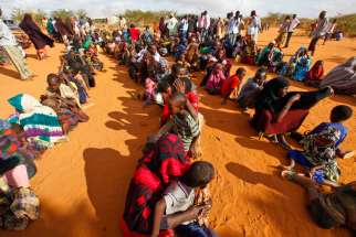 Refugees who fled the famine in Somalia wait in a reception area in 2011 at a camp in Dadaab, Kenya. Bishop Joseph Alessandro of the Garissa Diocese and the Jesuit Refugee Service are concerned about closing down the refugee camp with proper care.