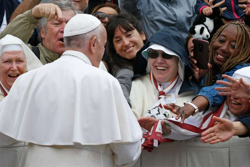 Pope Francis greets people during his general audience in St. Peter's Square at the Vatican May 29, 2019.